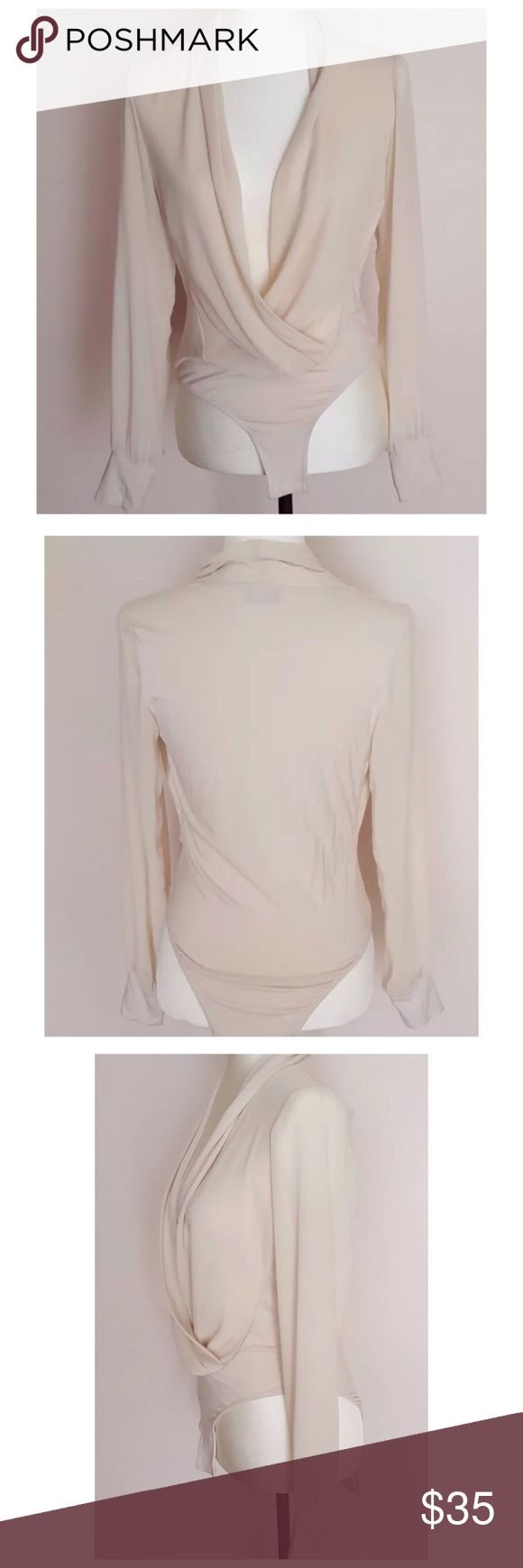 Bardot Cream Blouse / Bodysuit Size: Aus: 10, US: small (4-6)  Beige long sleeved leotard blouse.  It has a hole repair near the care tag. This area is tucked in, so it's not noticeable. Also, marked a size 6, but I would say closer to a 4. This is reflected in the price. Bardot Tops Blouses
