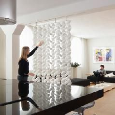 Use Room Dividers To Enhance Space In Your Living Area