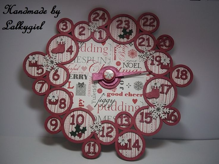 an advent calendar I have made using a chipboard die cut set from tando creations and some docrafts xmas paper and cosmic shimmer mists