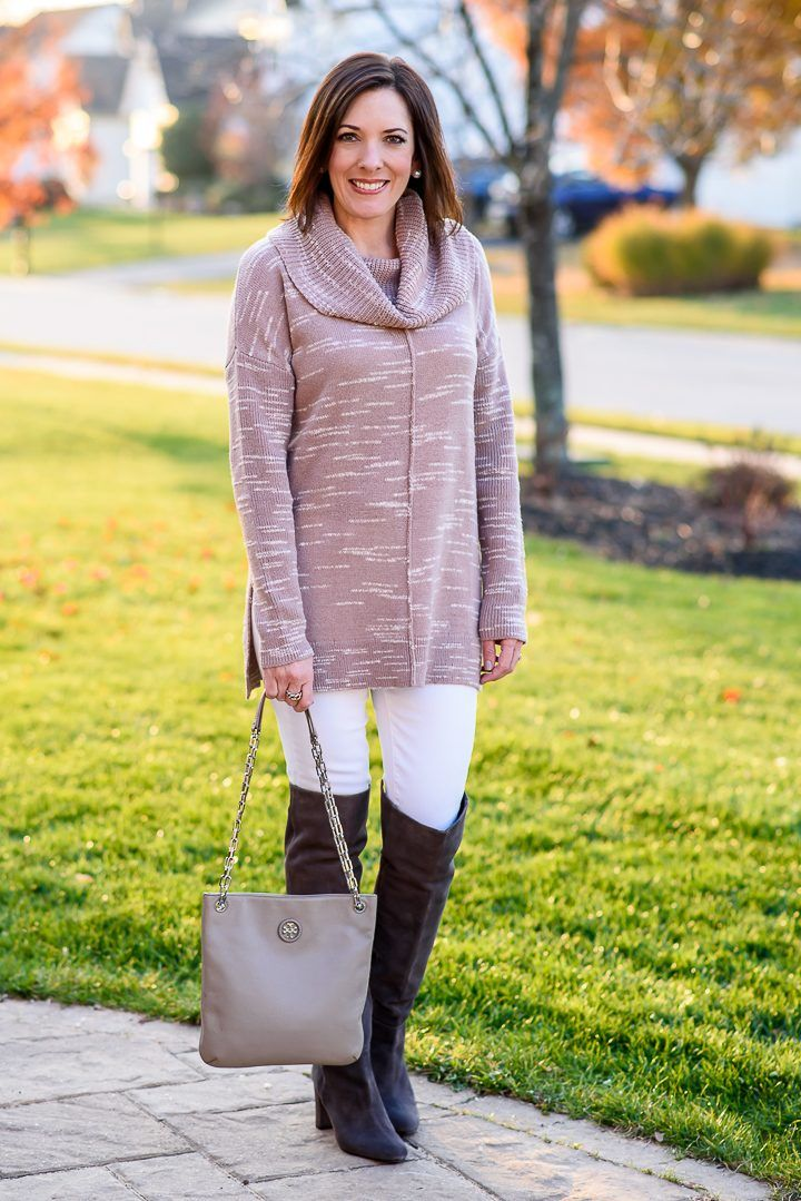 Jo-Lynne Shane styling a Winter Pastels Outfit with a Caslon side slit cowl neck tunic, white skinny jeans, and grey over the knee boots
