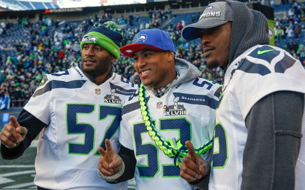 (L - R) Mike Morgan #57, Super Bowl MVP Malcolm Smith #53, and Anthony McCoy #85 of the Seattle Seahawks pose for a photo during ceremonies following the Seahawks' Super Bowl XLVIII Victory Parade at CenturyLink Field on February 5, 2014 in Seattle, Washington. (Photo by Otto Greule Jr/Getty Images)