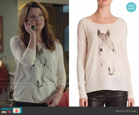 Lorelai's horse print sweater on Gilmore Girls: A Year in the Life.  Outfit Details: https://wornontv.net/63623/ #GilmoreGirls