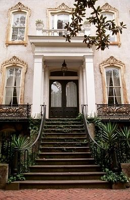 Savannah Row House - I love it that there is a Magnolia branch dipped down in the top of the pic....