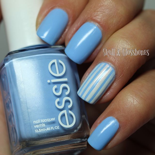 💀🖤 Essie Color of the Month - Bikini So Teeny 🖤💀This look was inspired by my shirt I wore for the 4th of July :) I also used Essie Sweet Soufflé for the stripes!