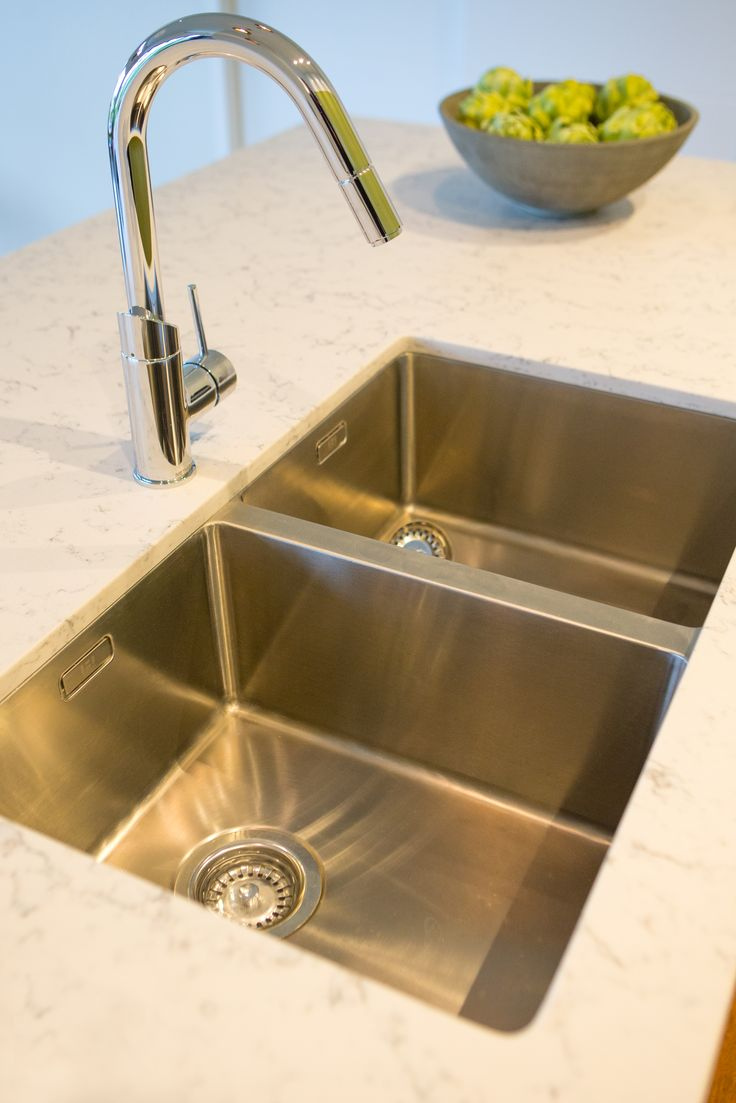 Heritage Hardware Robiq double sink undermounted into Silestone benchtop. Sally Steer Design.