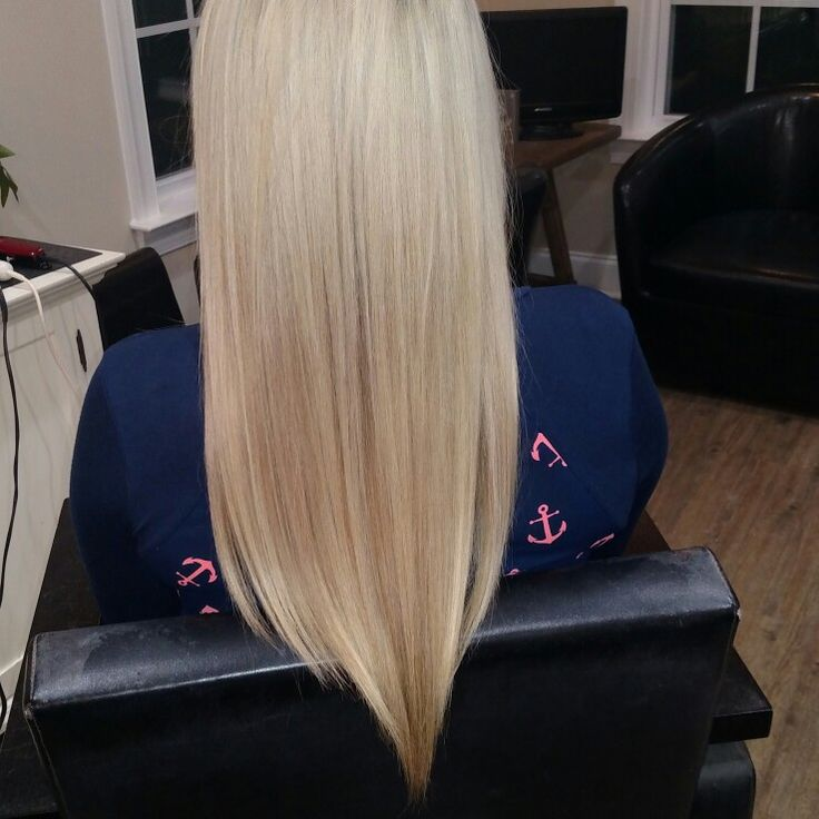 Long blonde hair with a v cut