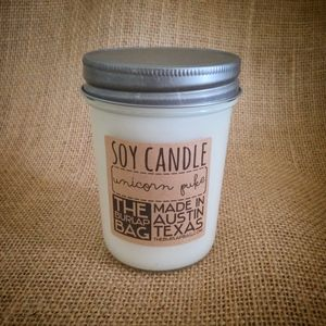 Mmm unicorn puke! Everyone knows what unicorn puke smells like... cotton candy! This candle smells delicious. And the name will make everyone laugh! Each soy candle is 8oz and in a glass jar. They are made of all natural soy and have a 70  hour burn time. Shipping is a flat $6 for as many candles as you want! 1 or 10!The candles are made by Josiah and Lauren - the crazy owners of The Burlap Bag! They are also for sale at our retail shop, The Burlap Bag, in Austin, Texas. Items will ship on…