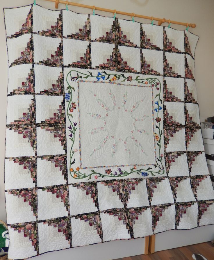 Another project completed.  I had a tablecloth that my mother embroidered and I wanted to put it in a quilt.  I used the 'thick and thin' log cabin block.  The 3-D applique around the tablecloth is from Pauline Ineson's book, Floral Dimensions.