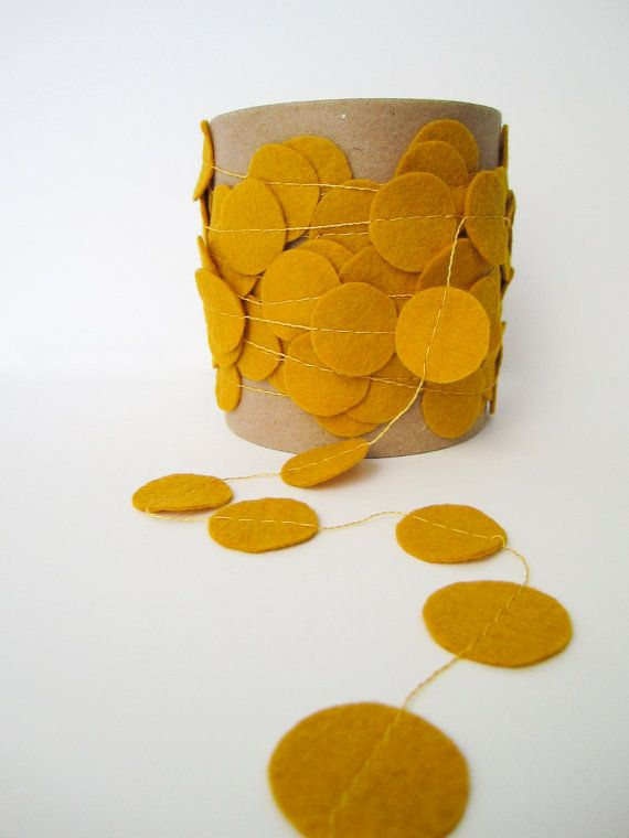 @ashley wilkins YES, this is like that Anthropology thing I was telling you about...cute in mustard!!   Inpiration for homemade wedding decor (Felt Garland  Yellow/Mustard by JaneeLookerse on Etsy, $15.00)