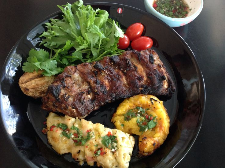 Spicy ribs with grilled fruits and mushrooms, plus spicy sauce and cilantro