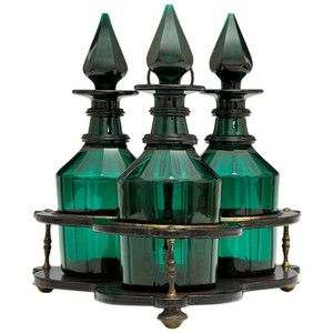 Set of Three Green Glass Victorian Decanters in Black Lacquer Stand