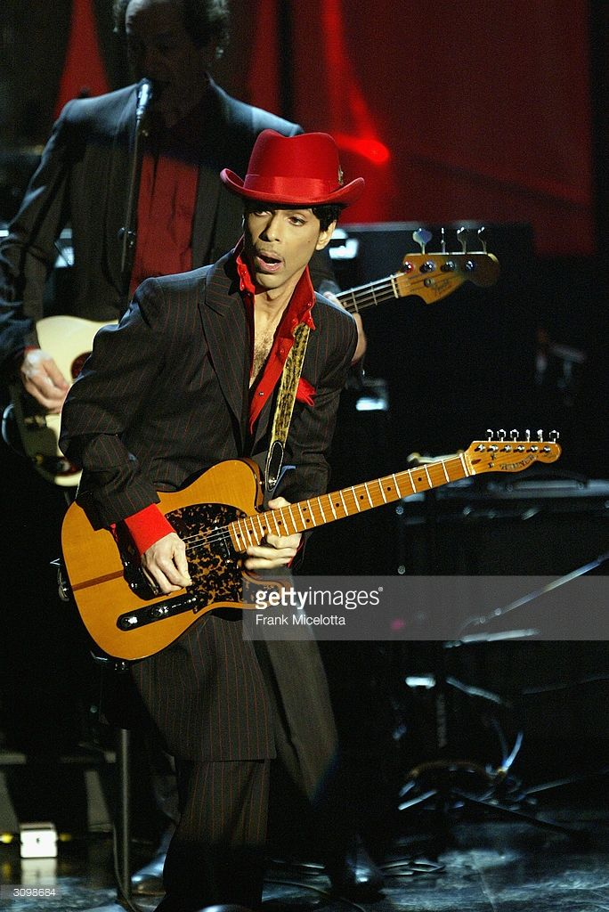 Inductee Prince performs following George Harrison's induction at the Rock & Roll Hall Of Fame 19th Annual Induction Dinner at the Waldorf Astoria Hotel March 15, 2004 in New York City.