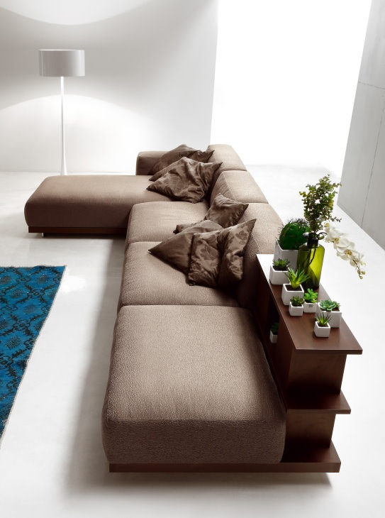 Modular sofa with chaise longue and a cute integrated bookshelf