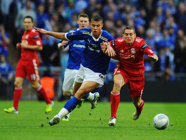 Daniel Agger of Liverpool battles with Rudy Gestede of Cardiff City during the Carling Cup Final match between Liverpool and Cardiff City at Wembley Stadium on February 26, 2012 in London, England.