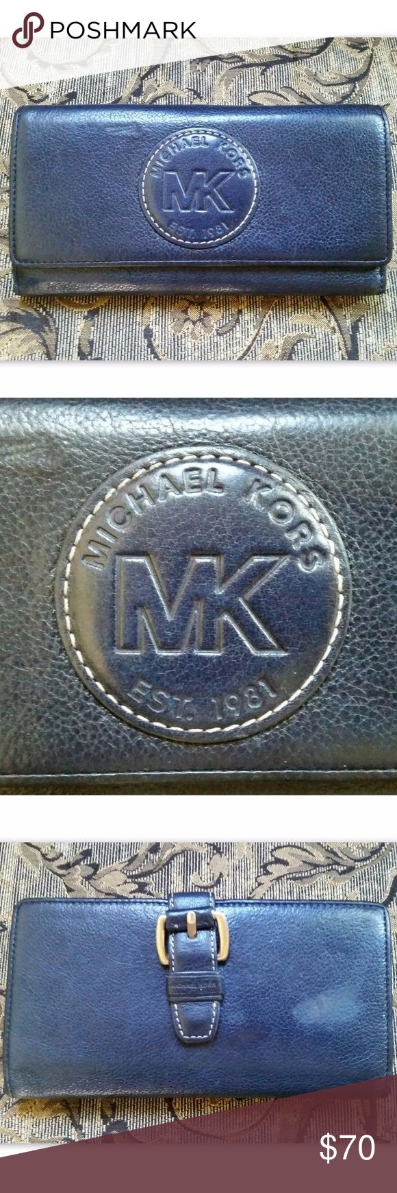 MICHAEL KORS Wallet Continental Blue Clutch 100% Authentic MICHAEL KORS Wallet Mainline Vintage Clutch Very good vintage condition - some areas of leather show surface rubbing (mainly on back), tons of use left. Very clean. See photos. Elegant continental flap wallet in dark navy blue leather. Silver tone hardware and buckle accent at back. Large MK logo front. Snap closure. Two large accordion style bill sections with zippered pocket divider. Backside opens to reveal ID holder, tons of card…