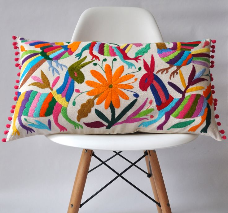 The fabric used to make this striking pillow cover has been hand embroidered by a group of female artisans with whom we work from Hidalgo, Mexico. The design is inspired by Otomí legends and the region's rich plant and animal life.