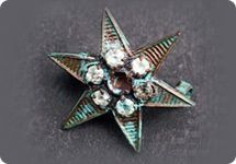 Titanic artifacts | Star pendant found in the wreckage of the Titantic. | Titanic