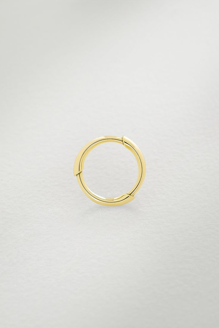 Photographer: Leo Bieber, featuring the Gold Kula Ring. The Gold Kula Ring is an all-round statement piece set in 18k Fairtrade gold. The bamboo plant - a species found in plentiful abundance on the Trobriand Islands - forms the basic design of the Kula range.