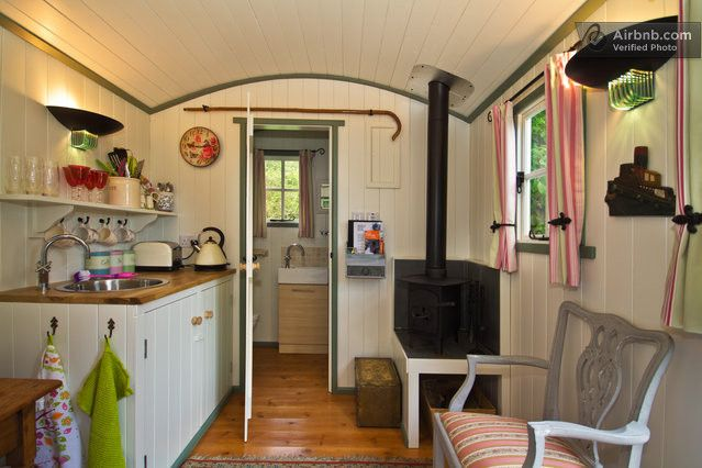 We like the wood burner and how it is off the ground with storage under.  Also like  the shaker style doors of cabinets