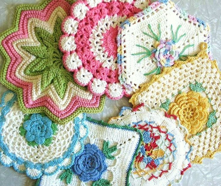 vintage potholders // My grandmothers made and received potholders like these for Christmas. They were always hung in the kitchen for display, not use...they were a beautiful addition to sparse lives.