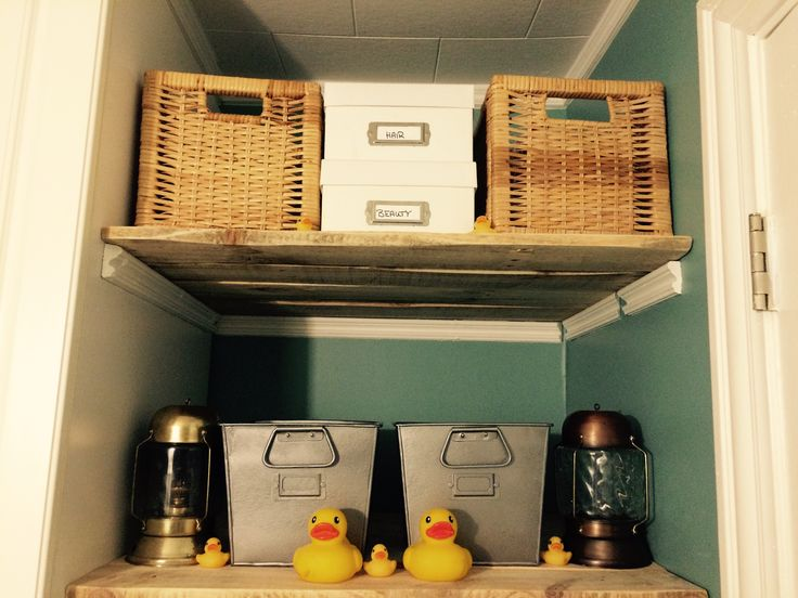 DIY painted metal baskets, old lanterns and rubber ducks for nautical bathroom