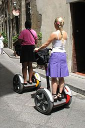 2001 - The Segway Human Transporter -- the first self-balancing, electric personal transportation  machine--is introduced. A computer helps keep the device upright. With a top speed of about 12 mph, the device has no brakes. Its speed and direction (including stopping) are controlled by the rider shifting weight and a manual turning mechanism on one of the handlebars. It can travel smoothly across pavement, gravel, grass,  and small obstacles. One battery charge lasts 15 miles.