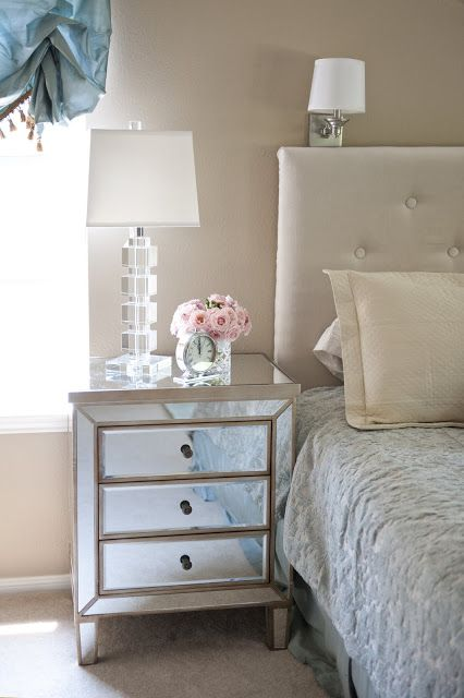 This mirrored side table and geometric crystal lamp from HomeGoods add a glamorous touch to this traditional bedroom