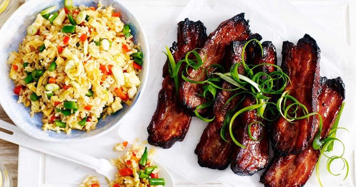 Create a delicious dish with these sticky char siu pork ribs served with quick fried rice.