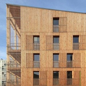 Paris housing blocks by Tectône Architectes are encased by timber louvres