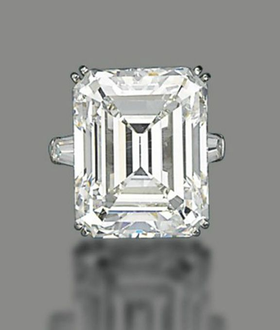 A DIAMOND RING, BY HARRY WINSTON. Set with a rectangular-cut diamond, weighing approximately 28.13 carats, to the tapered baguette-cut diamond shoulders, mounted in platinum