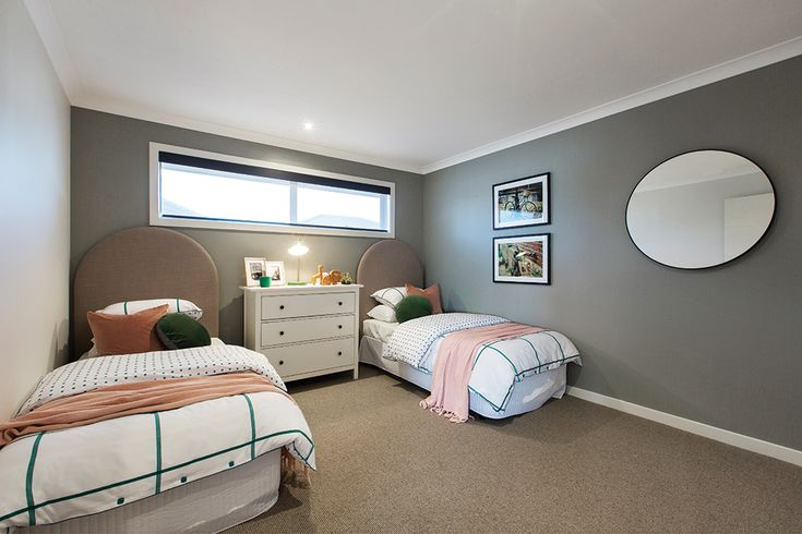 Twin bedroom in the Hoffman display with an Amsterdam World of Style.