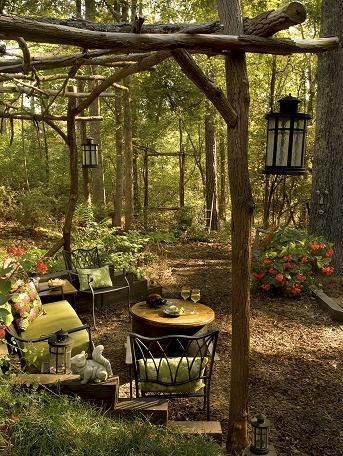 Gazebo built with fallen recycled trees. In distance the view is highlighted by a large picture frame how-should-my-garden-grow