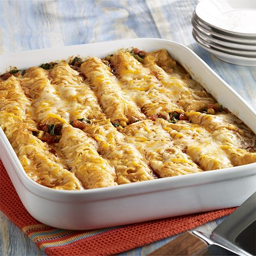 Refried beans, zesty tomatoes, chopped spinach, corn and cheese makes a flavorful filling for vegetarian enchiladas