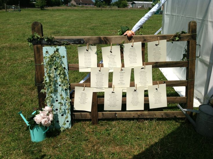 A great idea to use this old gate for the table plan at this wedding marquee on a farm in Hampshire.
