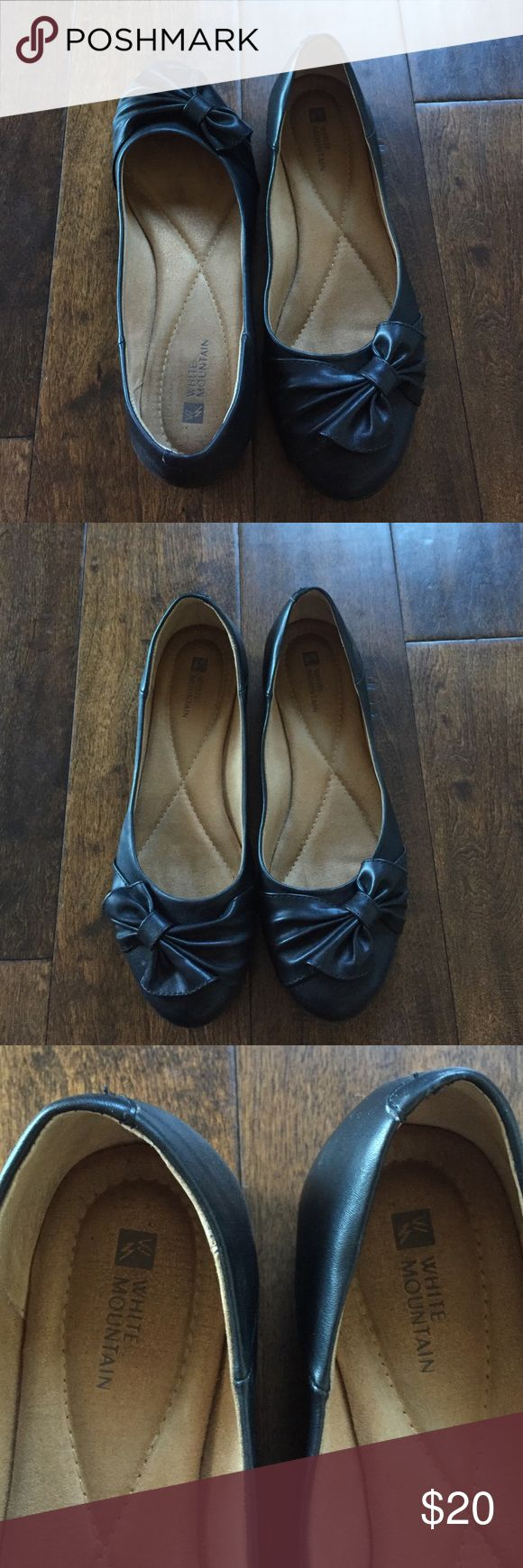 Black bow flats Very cute and super comfortable black flats with bow accent by White Mountain worn only a few times. Padded bottom for extra comfort. Size 9. White Mountain Shoes Flats & Loafers