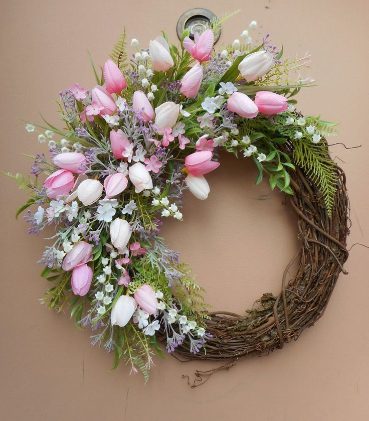 """This pretty handmade wreath measures 18"""" tall x 16"""" wide x 5"""" deep and is made on a 14"""" grapevine base. There are a variety of light and dark pink tulips, purple filler flowers and lily of the valley.   eBay!"""