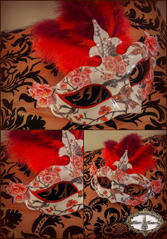 Red and white Venetian mask covered with chinoiserie paper. Totally hand-painted. The mask is beautifully decorated with pink fabric flowers and