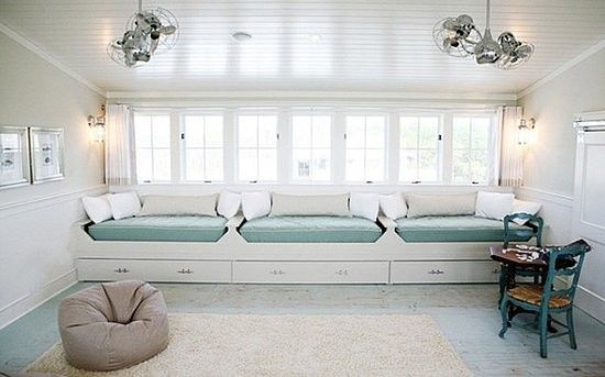 Wow-- that's a lot of daybeds! I think, like my Super Mom's space, this room is meant to stash a whole lot of grandkids! I love that daybeds can double as seating during the day, which turns this bedroom more into a play room while the sun is out.