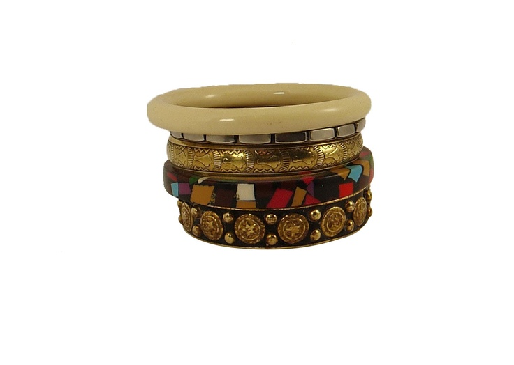 This set of 5 has unusual combination of bangles. There is one hand embossed antique gold tone bangle with intricate designs . one bamboo design bangle in silver tone , There is one bangle in classic shade of butter cream. There is one bangle in black with cheerful geometric patterns.in shades of orange, blue, yellow, pink and white. One crowing piece in this set has beautiful stars all around the bangle in rich antique gold tone.