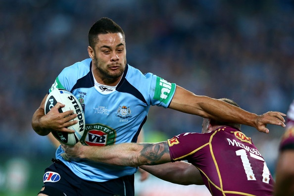 Jarryd Hayne of the Blues is tackled during game one of the ARL State of Origin series between the New South Wales Blues and the Queensland Maroons at ANZ Stadium on June 5, 2013 in Sydney, Australia.