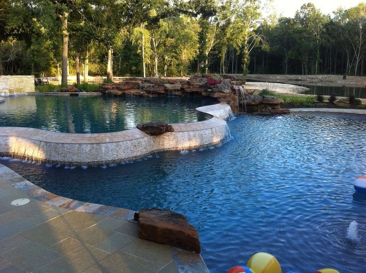 Lagoon Style Pool Designs the freeform design will allow you to create a natural lagoon style swimming pool with an exotic rock waterfall tropical landscaping sunshelf and a Lagoon Style Pool Pinned By Heather Hudson Realtor