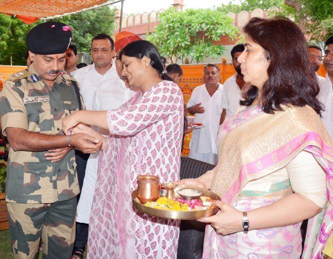 Smriti, Nirmala tie rakhi to 'brothers' at borders - Rediff.com India News