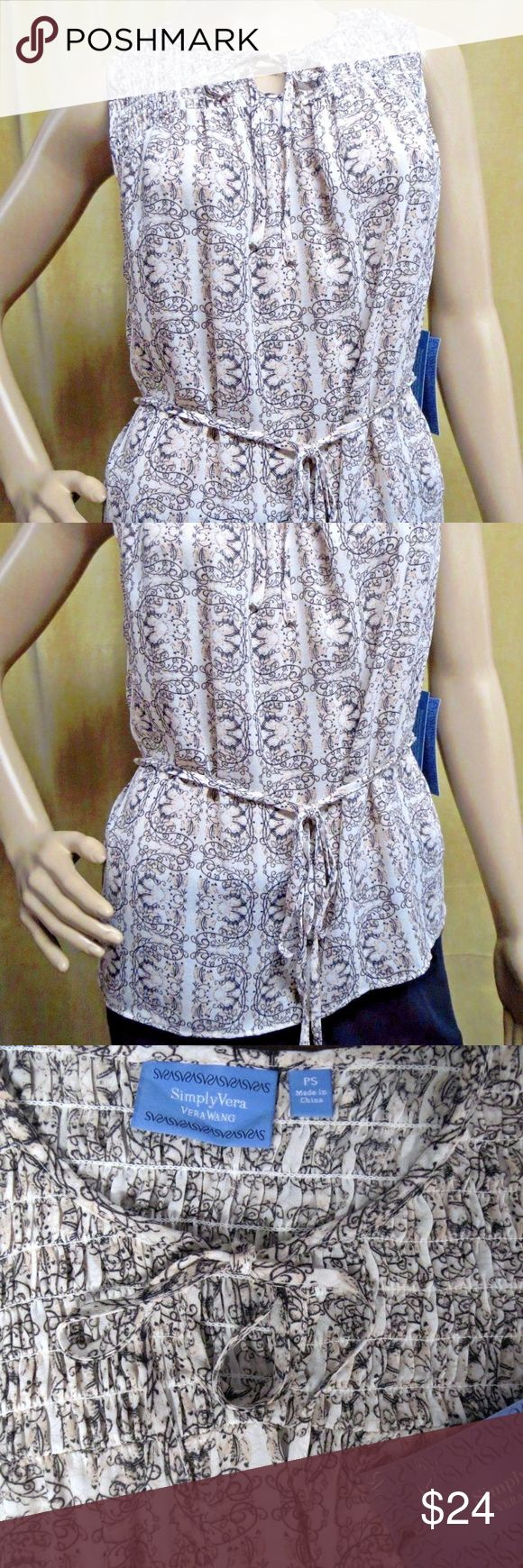 "Simply Vera Wang Petite Smocked Chiffon Blouse New NWT New Retail $48.00 Pullover belted tunic top Smocked yoke Scoop keyhole tie neckline Sleeveless Allover beige, taupe print  Chiffon semi sheer construction 100% polyester Machine washable       Size PXS:     Chest 17"" across front and length from shoulder to hem 22.5"".        Size PS :     Chest 18"" across front and length from shoulder to hem 23"". Simply Vera Vera Wang Tops"