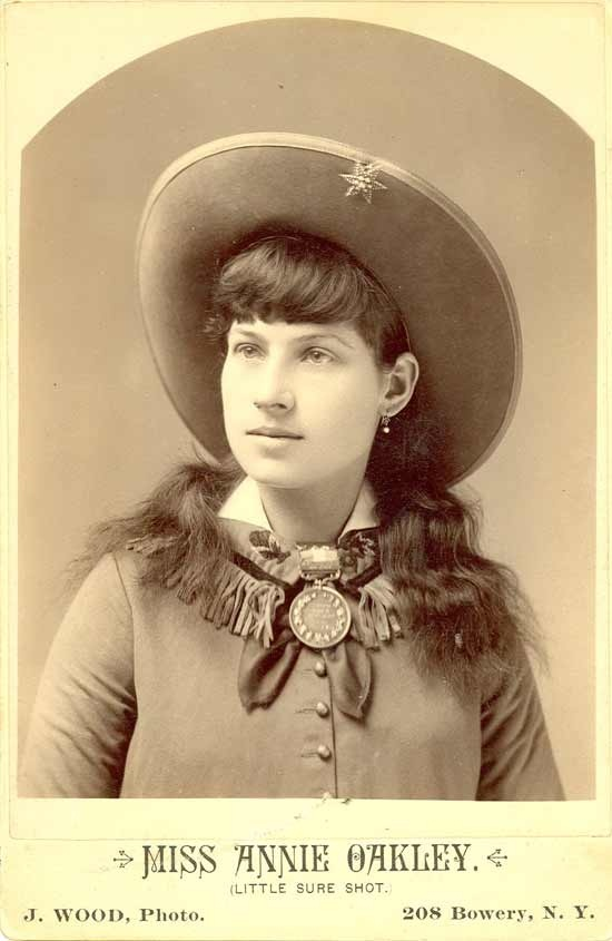 """Annie Oakley ~She could split a playing card edge and put six holes in it before it touched the ground with a .22 rifle from 90 feet away. Born into poverty in Ohio, Annie began hunting at age six to support her siblings and widowed mother before rising to fame as a sharp shooter with """"Buffalo Bill's Wild West Show"""" in 1885. During her career she performed for Presidents, Queens and taught upwards of 15,000 women how to use a gun."""