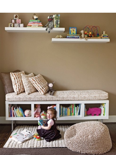 This bookshelf/reading nook/bench is EXACTLY what I have envisioned for under Lily's enormous window.  It's even elevated and airy enough that being directly over the heating grate won't be a problem!  *JOY*