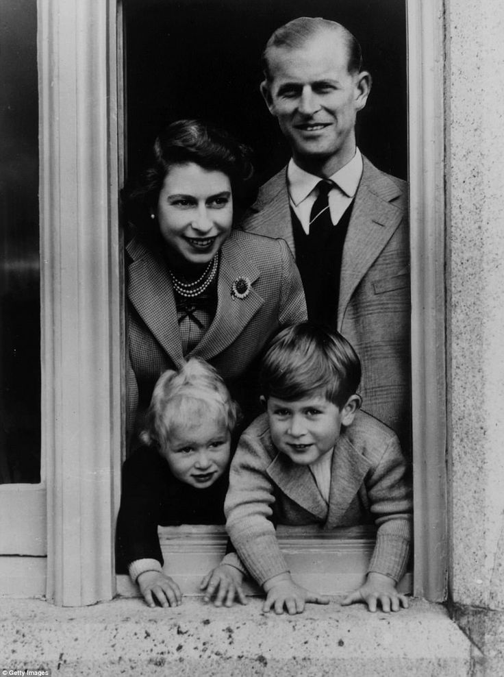 Happy family:This shot  shows the young Royal couple posing happily for a family portrait with their children Prince Charles and Princess Anne at Balmoral Castle. Queen Victoria's husband, Prince Albert, purchased the Castle in the 19th century