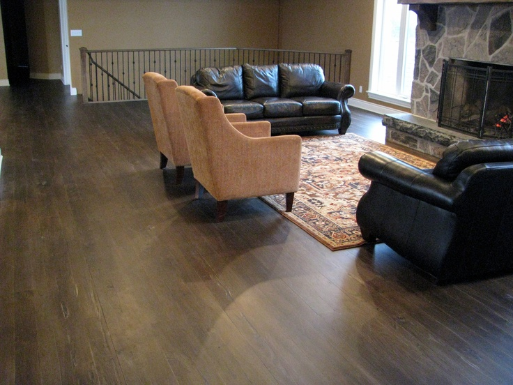 This grey elm hardwood floor was scraped on site, custom stained, and finished.