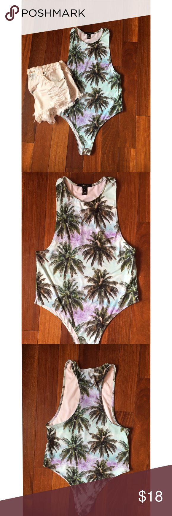 Forever 21 palm print bodysuit / swimsuit Super cute palm tree print body suit. Can be worn as hit suit. Worn once. Racer back and snap bottom. Forever 21 Tops