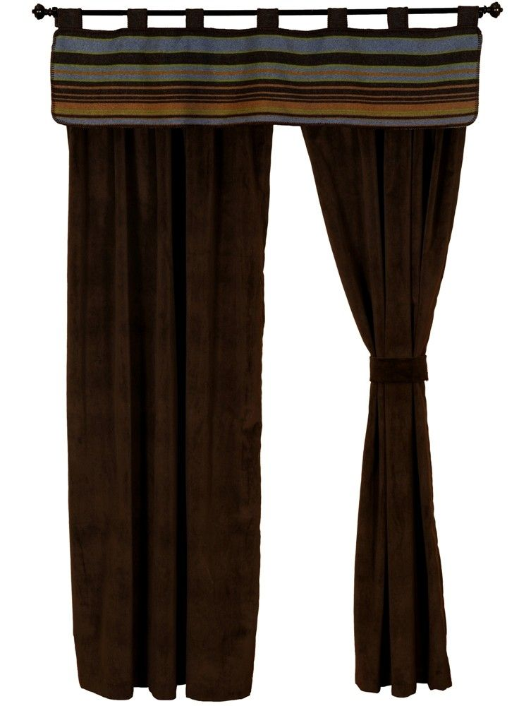 The window dressing made for he Hudson II Western Bed Ensemble set includes a matching window valance, a pair of 54 x 84 rod pocket drapery panels made of dark chocolate velvet suede called Bon Bon, and a pair of matching tiebacks.  However, it will work well with any Southwestern or Western themed room.   American made to order by Wooded River.