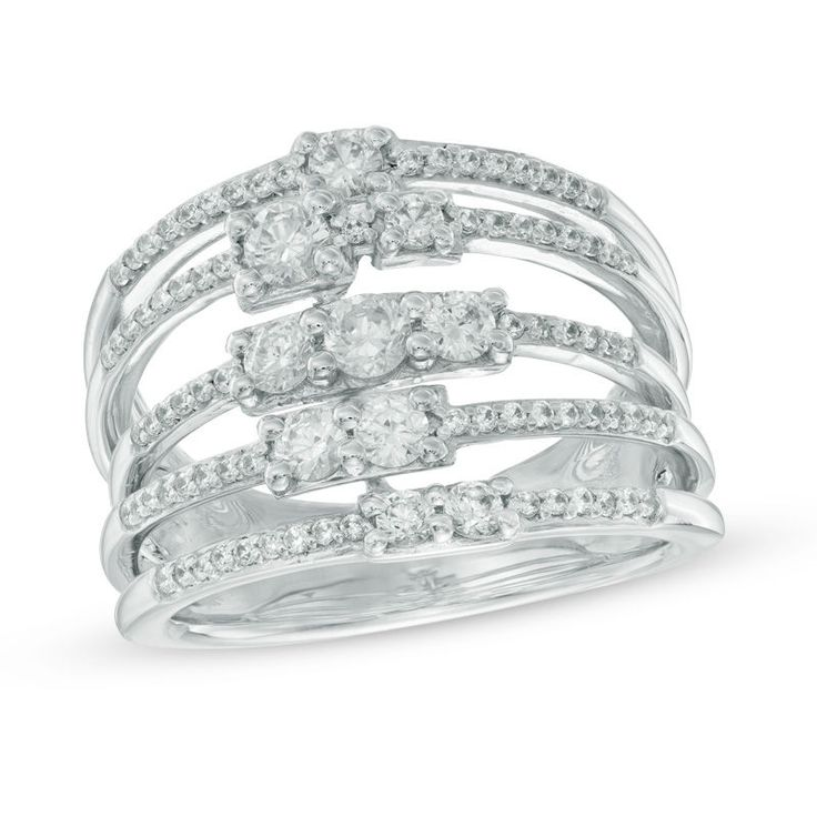 Treat her to an out-of-this-world look she'll love with this diamond fashion ring. Expertly crafted in 10K white gold, this ring features a brilliant array of glistening round diamonds in squared frames scattered along shimmering diamond-lined ribbons. An elegant, extravagant look, this ring captivates with 1 ct. t.w. of diamonds and a bright polished shine. This ring is only available in size 7.